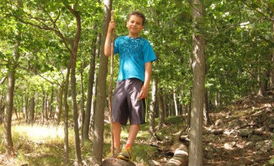 A young hiker enjoying a Blue-Blazed Hiking Trail