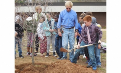 Students at Martin School planting a Dogwood donated by Burns & McDonnell on Arbor Day 2016