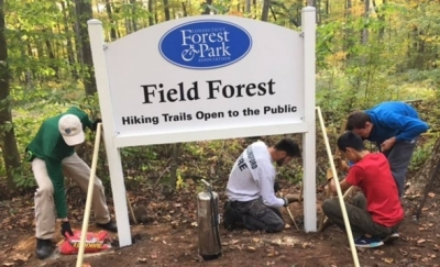 Spencer Alsup and his crew installing new signage at CFPA's Field Forest