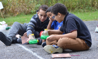 Windham Students study tadpoles at Goodwin Forest.