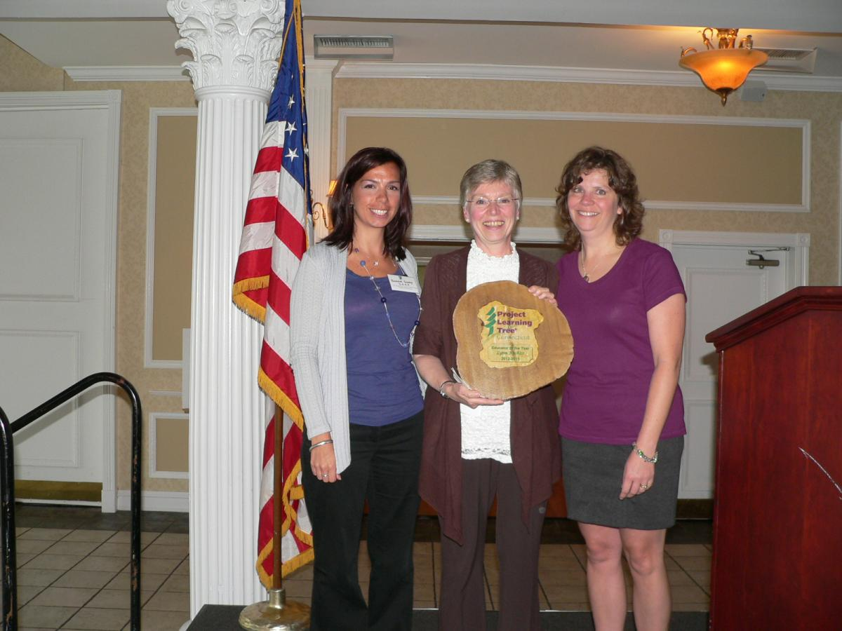 Lynn Kochiss (center) receives PLT CT Educator of the Year Award from Rachael Sunny (left) and Lori Paradis Brant (right).